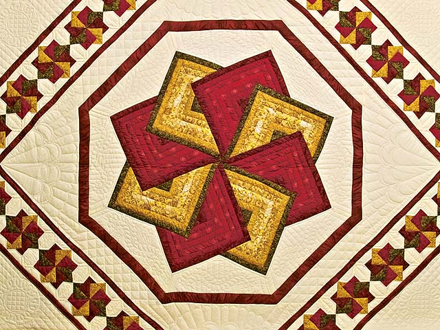 Green Burgundy and Gold Star Spin Quilt Photo 3