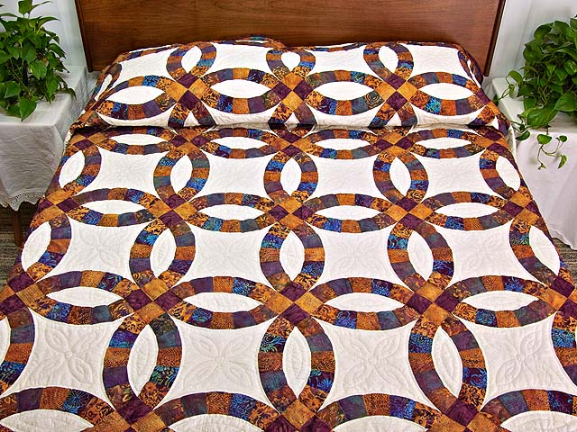Gold Purple and Blue Batik Double Wedding Ring Quilt Photo 1