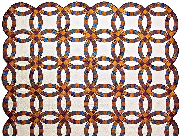 Gold Purple and Blue Batik Double Wedding Ring Quilt Photo 2