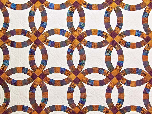 Gold Purple and Blue Batik Double Wedding Ring Quilt Photo 3