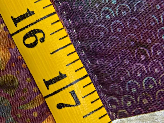 Gold Purple and Blue Batik Double Wedding Ring Quilt Photo 8