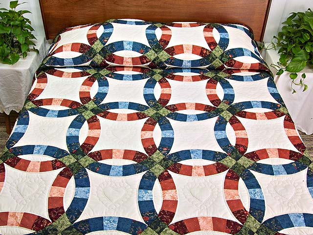 Blue and Red Double Wedding Ring Quilt Photo 1