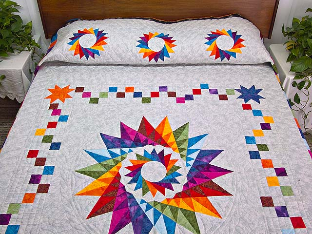 Multicolor Cartwheel Compass Quilt Photo 1
