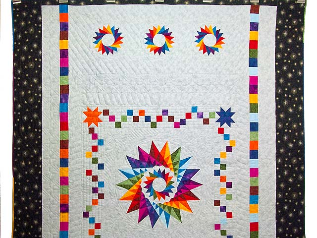 Multicolor Cartwheel Compass Quilt Photo 2