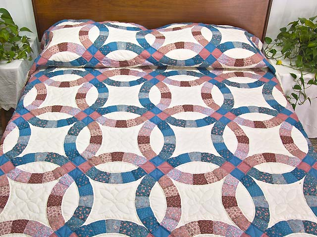 Blue and Rose Double Wedding Ring Quilt Photo 1