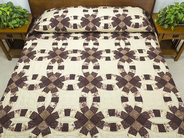 Brown and Tan Double Wedding Ring Quilt Photo 1