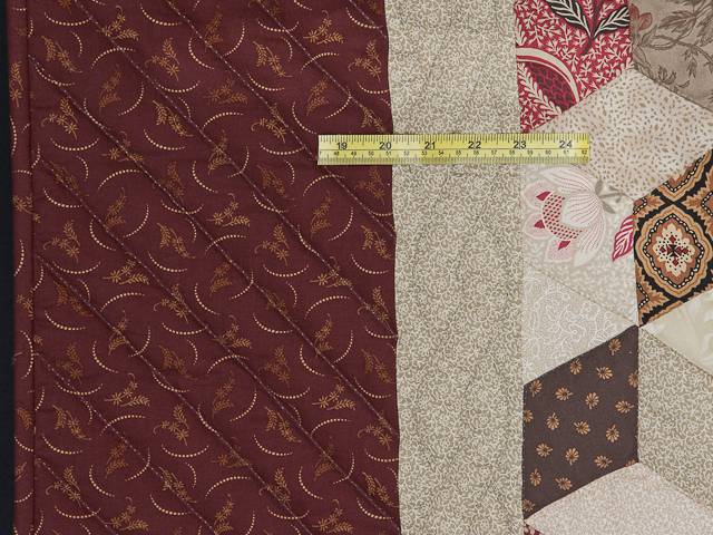 Burgundy and neutral Tumbling Blocks Quilt