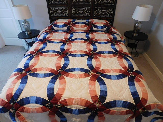 Navy and Salmon Double Wedding Ring Quilt Photo 1