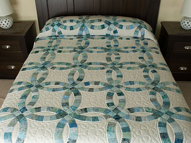 photo of Soft Aqua and Teals in Double Wedding Ring Quilt Queen bed Size