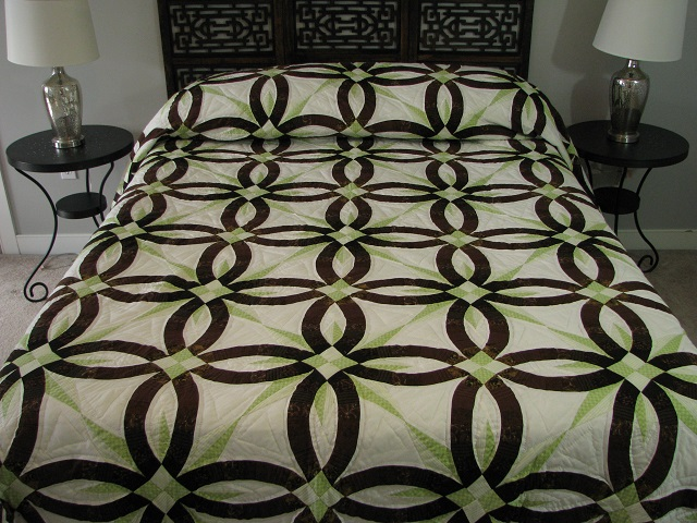 Brown with Green Star Wedding Ring Quilt Photo 1