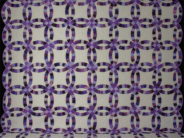 QUEEN SIZE BED Wedding Ring charming raspberry, purple, and lilac fabrics in batiks Photo 2