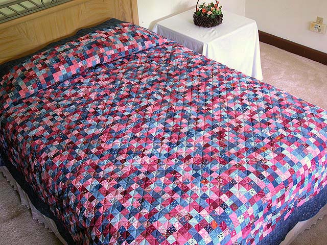 Blue and Rose Postage Stamp Quilt Photo 1