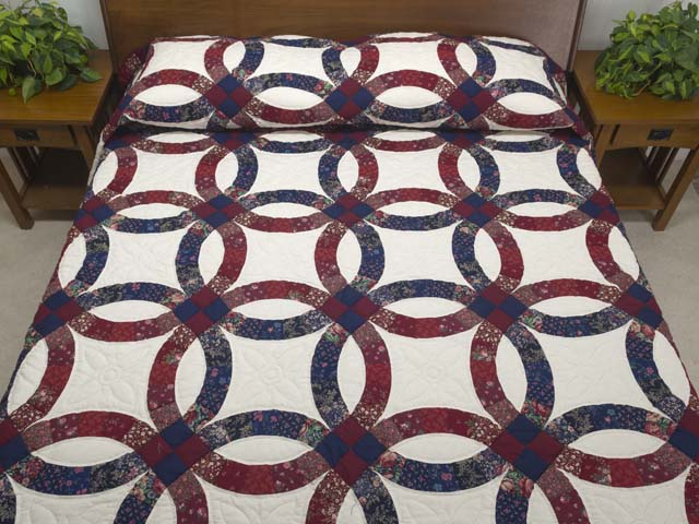 photo of King Cranberry and Navy Blue Double Wedding Ring Quilt