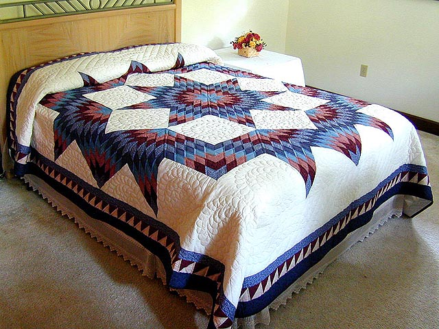 Brick Reds and Blue Broken Star Quilt Photo 1