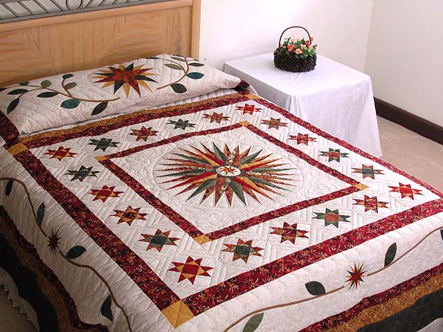 Red Green and Gold Mariner Compass Quilt Photo 1