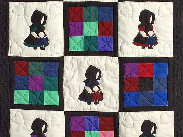 Amish Girl with Doll Nine Patch Crib Quilt Photo 2