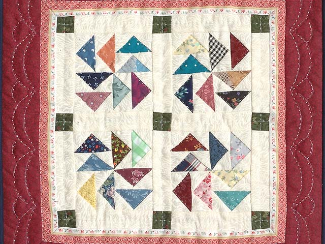 Miniature Red And Multi Dutchman Puzzle Quilt Photo 2