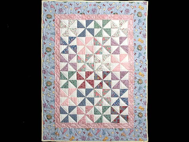 Pastel Blue and Pink Pinwheels Crib Quilt Photo 1