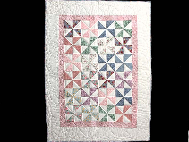 Pastel Pink and Multicolor Pinwheel Crib Quilt Photo 1