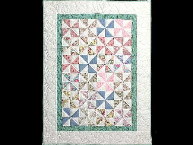 Pastel Green and Multicolor Pinwheel Crib Quilt Photo 1
