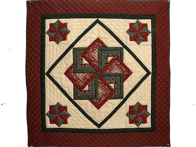 Burgundy Green and Tan Star Spin Wall Hanging Photo 1