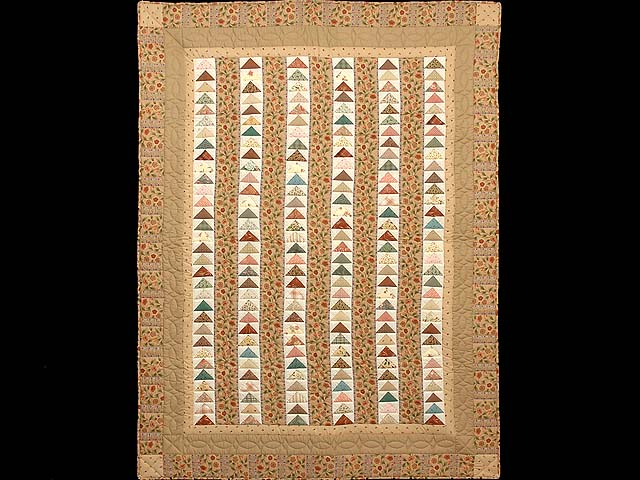 Tan and Multicolor Flying Geese Throw Photo 1