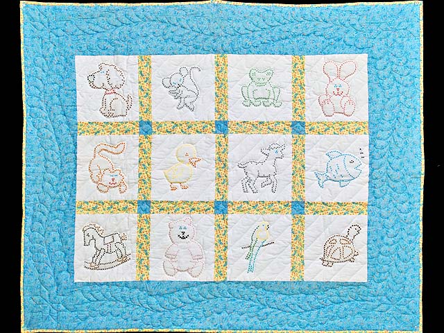 Blue and Yellow Cross Stitch Animals Crib Quilt Photo 1