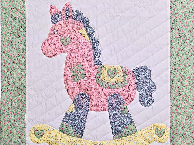 Pastel Green and Yellow Rocking Horse Crib Quilt Photo 2