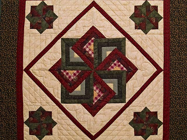 Green Burgundy and Tan Star Spin Wall Hanging Photo 2