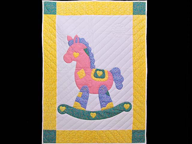 Yellow and Green Rocking Horse Crib Quilt Photo 1