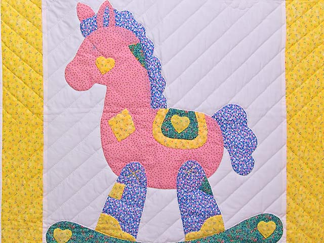 Yellow and Green Rocking Horse Crib Quilt Photo 2