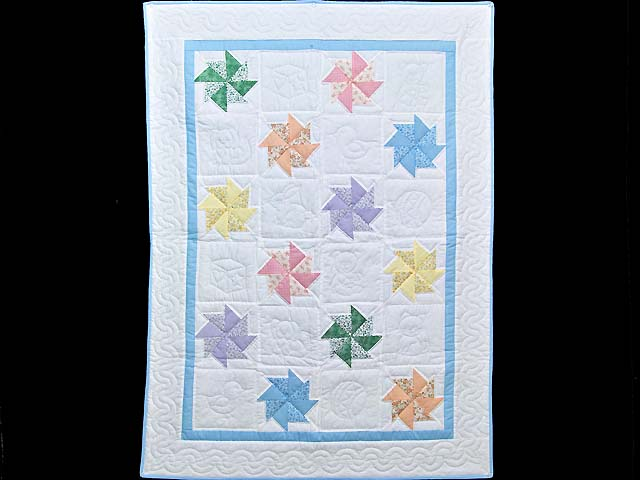 Pastel Blue and Multicolor Pinwheels Crib Quilt Photo 1