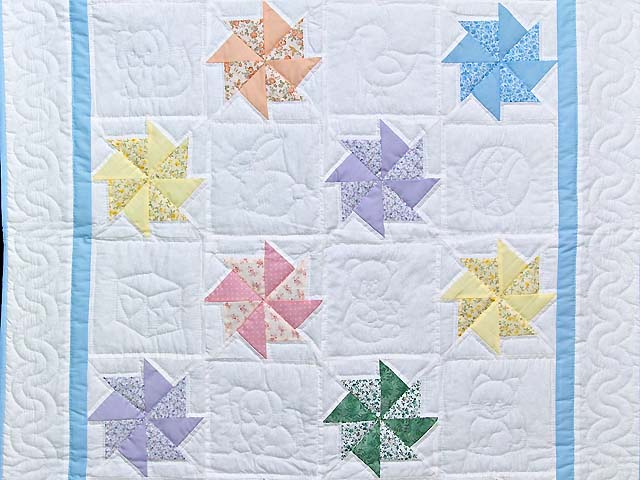 Pastel Blue and Multicolor Pinwheels Crib Quilt Photo 2