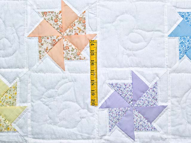 Pastel Blue and Multicolor Pinwheels Crib Quilt Photo 3