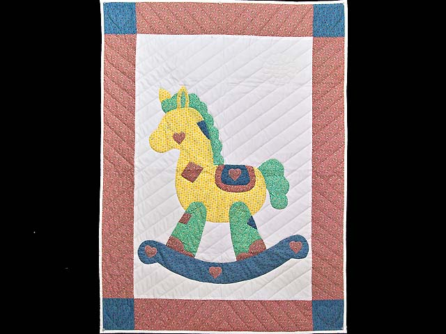 Pink and Blue Rocking Horse Crib Quilt Photo 1