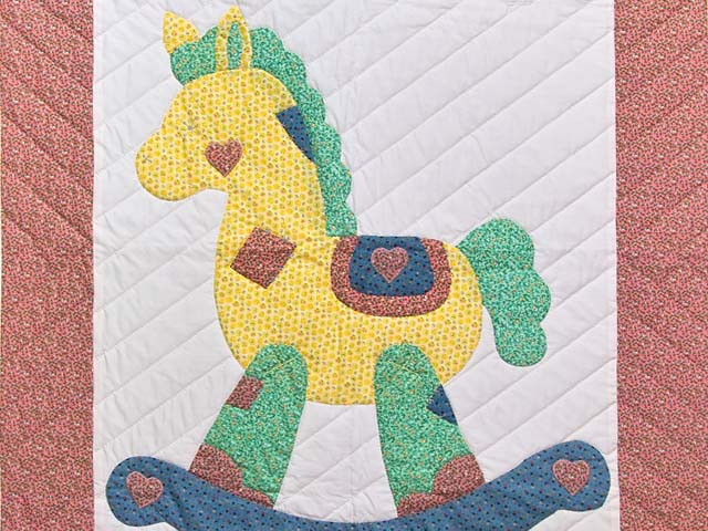 Pink and Blue Rocking Horse Crib Quilt Photo 2