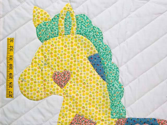 Pink and Blue Rocking Horse Crib Quilt Photo 3