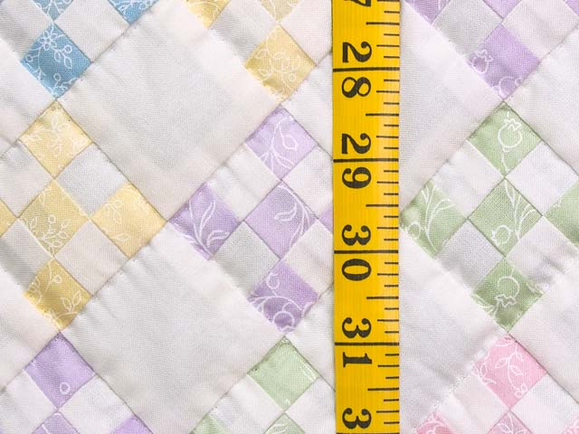 Pastels and Cream Nine Patch Crib Quilt Photo 4