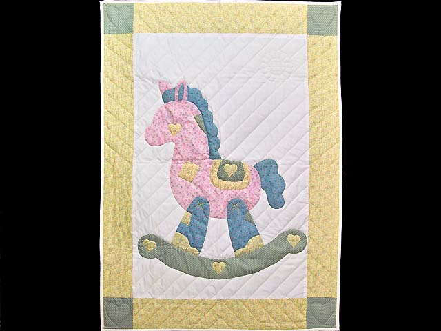Pastel Yellow and Green Rocking Horse Crib Quilt Photo 1