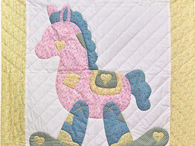 Pastel Yellow and Green Rocking Horse Crib Quilt Photo 2