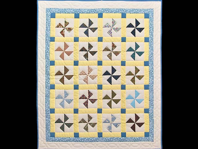 Blue and Yellow Flying Pinwheels Crib Quilt Photo 1