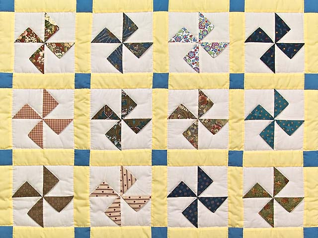 Blue and Yellow Flying Pinwheels Crib Quilt Photo 2