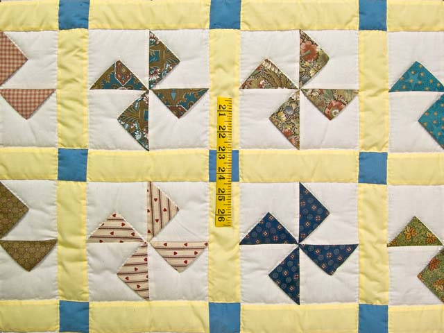 Blue and Yellow Flying Pinwheels Crib Quilt Photo 3
