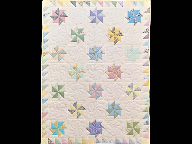 Pastel  Pinwheels Crib Quilt Photo 1