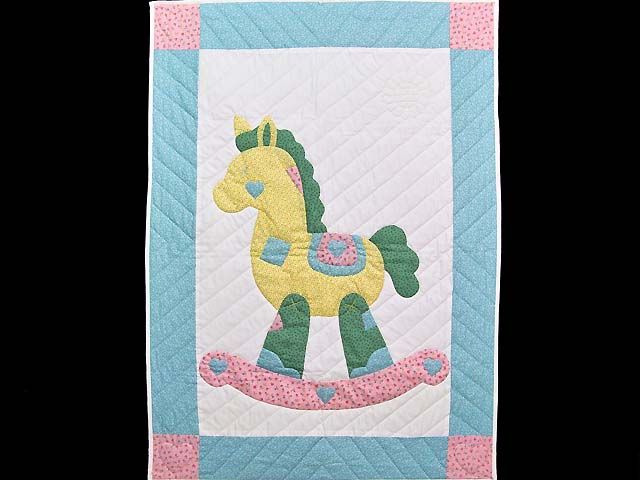 Pastel Aqua Blue and Pink Rocking Horse Crib Quilt Photo 1