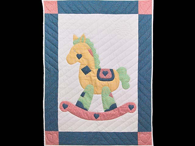 Bright Blue and Pink Rocking Horse Crib Quilt Photo 1