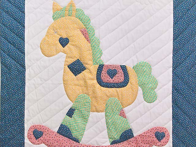 Bright Blue and Pink Rocking Horse Crib Quilt Photo 2