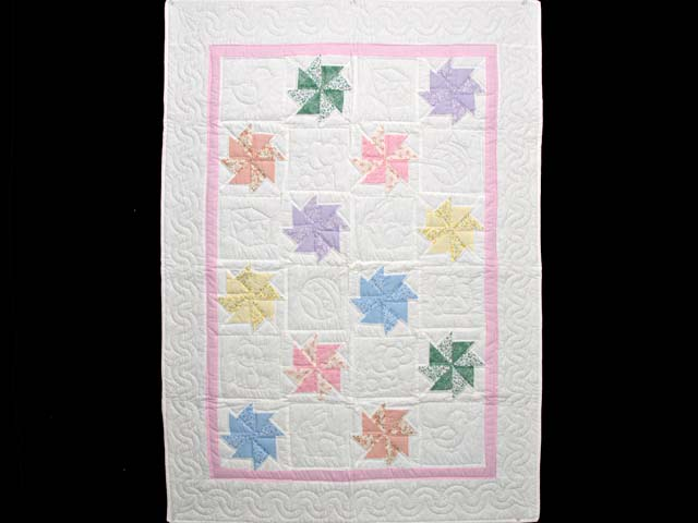 Pastel Pink and Multicolor Pinwheels Crib Quilt Photo 1