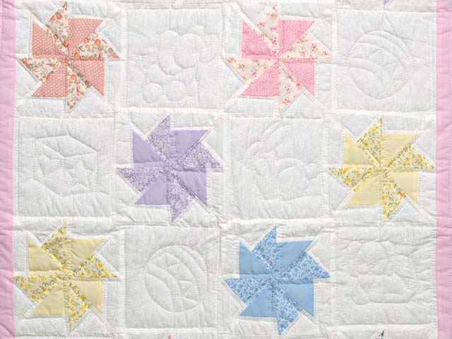 Pastel Pink and Multicolor Pinwheels Crib Quilt Photo 2
