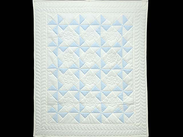 Pastel Blue and Cream Pinwheel Crib Quilt Photo 1